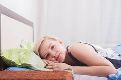 Young beautiful woman woke up in bed close-up stock photos