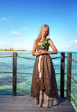 Young beautiful woman  on a wooden platform over  the sea Royalty Free Stock Photography