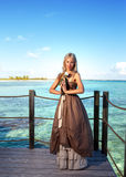 Young beautiful woman  on a wooden platform over  the sea Stock Photo