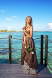 Young beautiful woman  on a wooden platform over  the sea Royalty Free Stock Images
