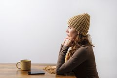 Young woman with coffee and smartphone Royalty Free Stock Photos