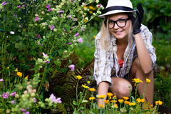 Young beautiful woman working in her garden Royalty Free Stock Images