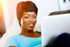 Young beautiful woman working on her laptop Stock Image