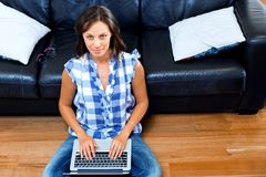 Young beautiful woman working on her laptop Royalty Free Stock Photography