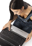 Young beautiful woman working on laptop Royalty Free Stock Photo