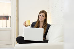 Young beautiful woman working with laptop computer smiling happy or doing online internet shopping Royalty Free Stock Photos