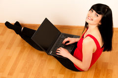 Young beautiful woman working on laptop Royalty Free Stock Images