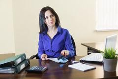 Young beautiful woman at workplace in office Royalty Free Stock Photo
