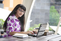 Young beautiful woman works outdoor Stock Images