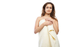 Young beautiful woman wrapped in towel after bath. Portrait of young beautiful woman wrapped in towel after bath. Spa. Isolated over white background Stock Images