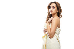 Young beautiful woman wrapped in towel after bath Royalty Free Stock Photo