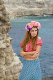 Young beautiful woman in a wreath enjoys sunny day Royalty Free Stock Image