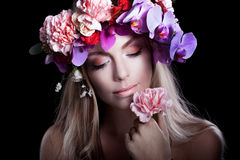Young beautiful woman in wreath of flowers presses Royalty Free Stock Photo