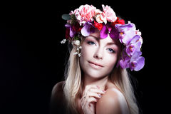 Young beautiful woman in wreath of flowers smiles Stock Photo