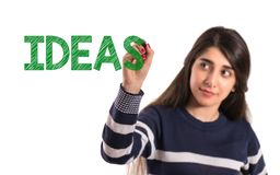 Teen college girl write ideas on transparent screen royalty free stock photography