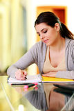 Young beautiful woman writing notes Royalty Free Stock Photo