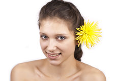 Young beautiful woman with yellow flower. On a white background royalty free stock photography