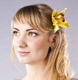 Young beautiful woman with yellow flower Royalty Free Stock Photos