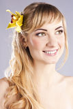 Young beautiful woman with yellow flower Stock Image