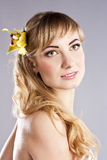 Young beautiful woman, with yellow flower Royalty Free Stock Photos