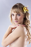 Young beautiful woman, with yellow flower Royalty Free Stock Images