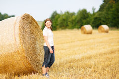 Young beautiful woman on yellow golden hay field, Germany Royalty Free Stock Photo