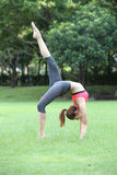 Young beautiful woman yoga instructor doing Wheel Pose with one Royalty Free Stock Photos