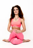 Young beautiful woman yoga posing in asana Stock Photo