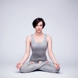 Young beautiful woman yoga posing Royalty Free Stock Images