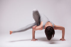 Young beautiful woman yoga posing Stock Images