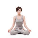 Young beautiful woman yoga posing. isolated Royalty Free Stock Photography