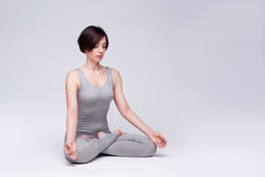 Young beautiful woman yoga posing. isolated Stock Photography
