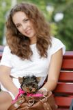 Young beautiful woman with yorkshire terrier Royalty Free Stock Photography