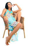 The young beautiful women. The young beautiful girl sits in an armchair Royalty Free Stock Image