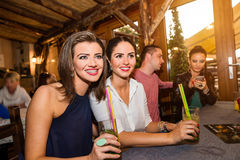 Young beautiful women with cocktails in bar or club Royalty Free Stock Images