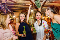Young beautiful women with cocktails in bar or club Royalty Free Stock Photos