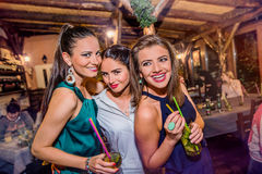 Young beautiful women with cocktails in bar or club Royalty Free Stock Photography