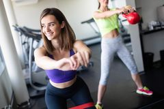 Young beautiful woman doing exercises in gym. royalty free stock image