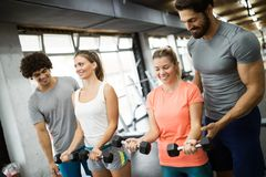 Young beautiful women doing exercises with personal trainers stock photography