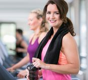 Beautiful woman are doing sport in a gym stock photo
