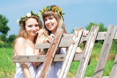 Young Beautiful Women drinking tea Outdoors in Summer. Stock Photography