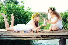 Young Beautiful Women drinking tea Outdoors in Summer. Stock Images