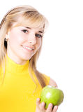 Young beautiful women eating apple. Young beautiful girl with fruit in her hands, isolated on white Stock Photo