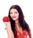Young beautiful women eating apple. Young beautiful girl with apple in her hands, isolated on white Stock Image
