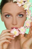 Young beautiful women with flowers Stock Photos