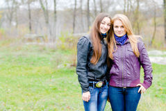 Two Teen Girl Friends Laughing in spring or autumn outdoors Royalty Free Stock Photos