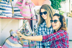 Young beautiful women girlfriends at flea market looking for bag Royalty Free Stock Photos