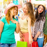 Young beautiful women girlfriends at flea market shopping clothes Stock Images