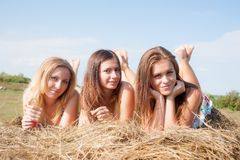Young beautiful women on hay Stock Photos