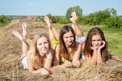 Young beautiful women on hay Stock Images